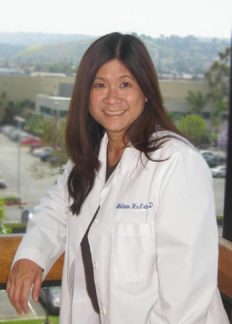 Doctor Melanie Ho Erb, M.D. in formal White Coat